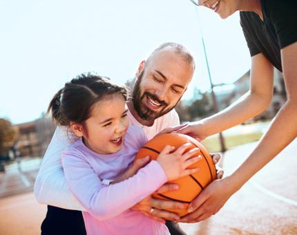 family playing basketball