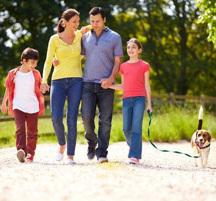 family walking dog together