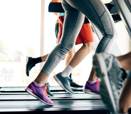 viewof people's legs running on treadmills