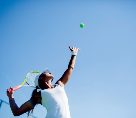 woman about to serve a tennis ball